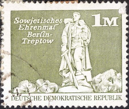 treptow: MOSCOW, RUSSIA - JANUARY, 2016: a post stamp printed in DDR shows the Soviet War Memorial, Treptow, Berlin, the series Buildings, circa 1973