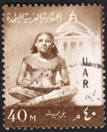 scribe: MOSCOW, RUSSIA - JANUARY, 2016: a post stamp printed in United Arab Republic (UAR) shows a sculpture of the seated scribe, the series National Symbols, circa 1959 Editorial