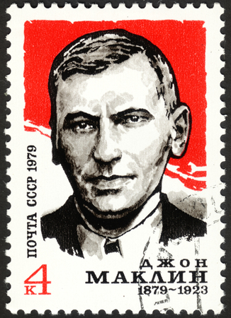 postmail: MOSCOW, RUSSIA - DECEMBER, 2015: a post stamp printed in the USSR shows a portrait of John McClean, devoted to the 100th Anniversary of the Birth of John McClean, circa 1979