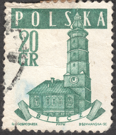 estampilla: MOSCOW, RUSSIA - CIRCA JANUARY, 2016: a post stamp printed in POLAND shows a Town Hall, Biecz, the series Town Halls, circa 1958