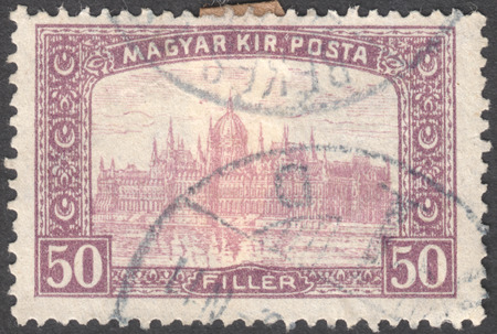 philatelist: MOSCOW, RUSSIA - JANUARY, 2016: a post stamp printed in HUNGARY shows the Parliament Building in Budapest with the inscription Magyar Kir.Posta, the series  Parliament, Budapest, circa 1917-1919