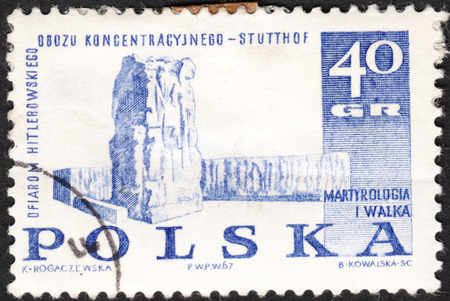 sacrifices: MOSCOW, RUSSIA - JANUARY, 2016: a post stamp printed in POLAND shows Stutthof memorial, the series Memorials for the Sacrifices of World War II, circa 1967