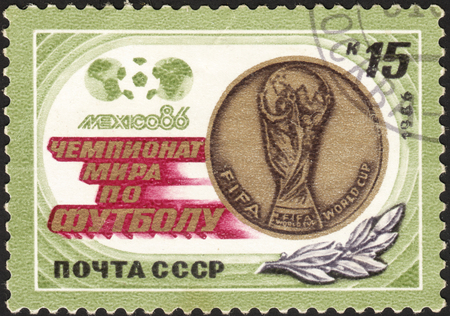 football world cup: MOSCOW, RUSSIA - DECEMBER, 2015: a post stamp printed the USSR and devoted to the Football World Cup - Mexico 1986, circa 1986