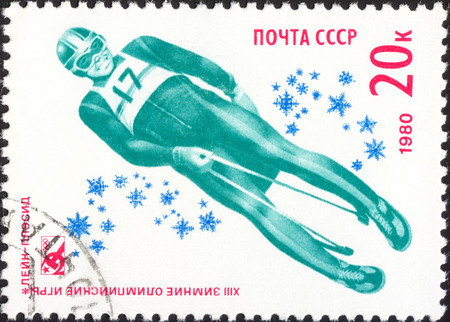 placid: MOSCOW, RUSSIA - DECEMBER, 2015: a post stamp printed the USSR shows luge, the series Winter Olympic Games - Lake Placid, USA, circa 1980 Editorial