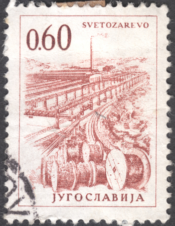 tuzla: MOSCOW, RUSSIA - JANUARY, 2016: a post stamp printed in YUGOSLAVIA shows a plant in Svetozarevo, the series Technology and Architecture, circa 1961