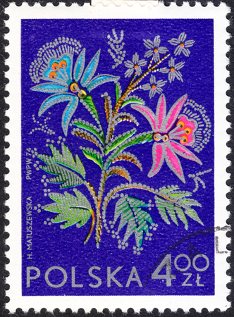 philatelic: MOSCOW, RUSSIA - CIRCA JANUARY, 2016: a post stamp printed in POLAND shows an embroidery, the series International Philatelic Exhibition Socphilex IV in Katowice - Flowers, circa 1974