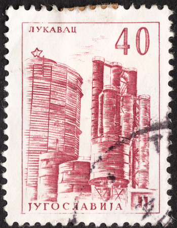 tuzla: MOSCOW, RUSSIA - JANUARY, 2016: a post stamp printed in YUGOSLAVIA  shows the Coke plant, Lukavac, the series Technology and Architecture, circa 1961