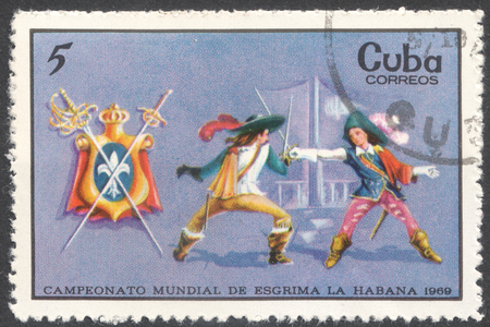 mosquetero: MOSCOW, RUSSIA - CIRCA FEBRUARY, 2016: a post stamp printed in CUBA shows musketeer fencing, the series World Fencing Championships, Havana, circa 1969