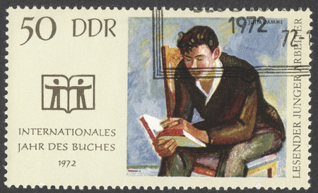 ddr: MOSCOW, RUSSIA - CIRCA JANUARY, 2016: a post stamp printed in DDR devoted to the International Book Year, circa 1972