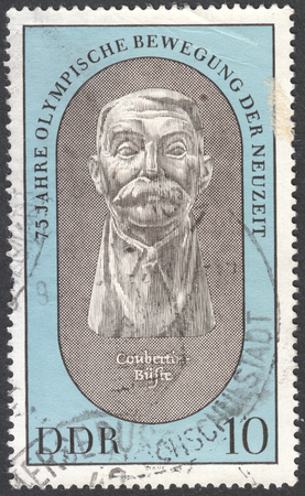 postmail: MOSCOW, RUSSIA - CIRCA JANUARY, 2016: a post stamp printed in DDR shows a portrait of Pierre de Coubertin, the series The 75th Anniversary of Modern Olympics, circa 1969 Editorial