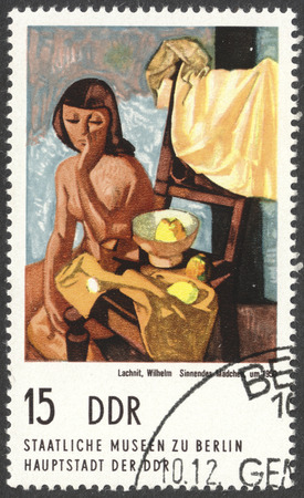 philatelist: MOSCOW, RUSSIA - CIRCA FEBRUARY, 2016: a stamp printed in DDR shows a painting A girl lost in thought by Wilhelm Lakhno, the series Berlin. Municipal gallery, circa 1974 Editorial