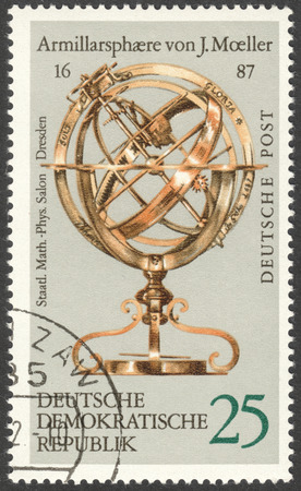 ddr: MOSCOW, RUSSIA - CIRCA FEBRUARY, 2016: a post stamp printed in DDR shows armillary sphere by J. Moeller, 1687, the series Globes, circa 1972