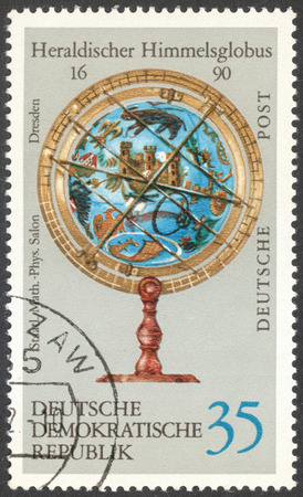 ddr: MOSCOW, RUSSIA - CIRCA FEBRUARY, 2016: a post stamp printed in DDR shows heraldic sky-globe, the series Globes, circa 1972 Editorial