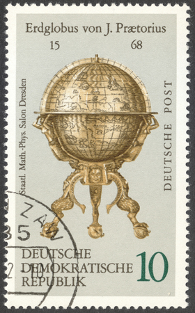 ddr: MOSCOW, RUSSIA - CIRCA FEBRUARY, 2016: a post stamp printed in DDR shows a vintage globe, the series Globes, circa 1972
