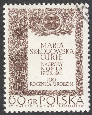 isotopes: MOSCOW, RUSSIA - CIRCA JANUARY, 2016: a post stamp printed in POLAND, the series The 100th Anniversary of the Birth of Maria Sklodowska-Curie, circa 1967 Editorial