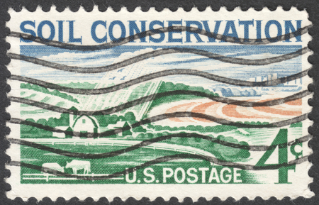 MOSCOW, RUSSIA - JANUARY, 2016: a post stamp printed in the USA shows a modern farm and devoted to the soil conservation, circa 1959 Editorial