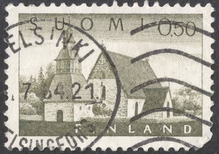 post stamp: MOSCOW, RUSSIA - JANUARY, 2016: a post stamp printed in FINLAND shows an old church in Lammi, the series Different daily stamps in large format, circa 1963