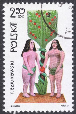 adam and eve: MOSCOW, RUSSIA - CIRCA FEBRUARY, 2016: a post stamp printed in POLAND shows a statue Adam and Eve, the series The 19th Century Popular Sculptures, circa 1969