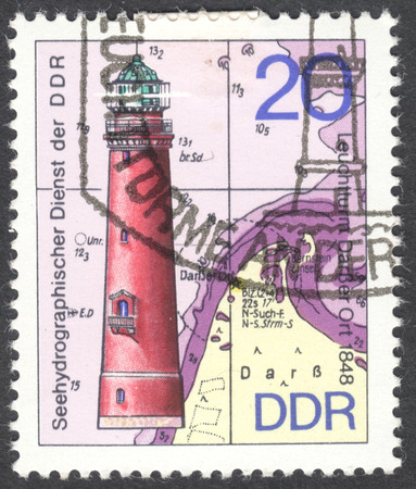 ddr: MOSCOW, RUSSIA - JANUARY, 2016: a post stamp printed in DDR shows the Darsser Ort lighthouse, the series Lighthouses, circa 1974