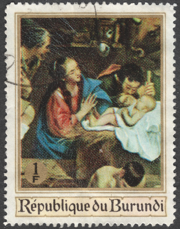 adoration: MOSCOW, RUSSIA - CIRCA JANUARY, 2016: a post stamp printed in BURUNDI shows painting The Adoration of the Shepherds by J. Mayno, the series Christmas - Religious Paintings, circa 1967