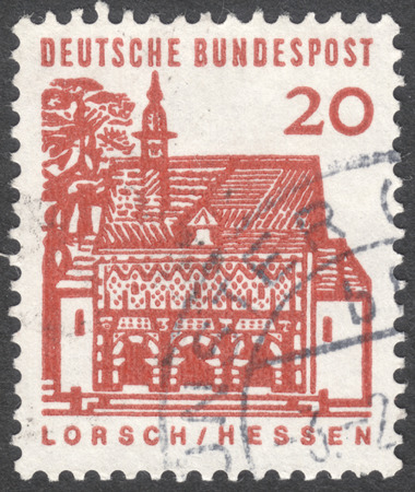 bundespost: MOSCOW, RUSSIA - JANUARY, 2016: a post stamp printed in GERMANY shows Monastery Gate, Lorsch, the series German Building Structures of the 12th Century, circa 1964 Editorial