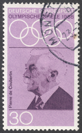 coubertin: MOSCOW, RUSSIA - CIRCA JANUARY, 2016: a stamp printed in GERMANY shows a portrait of Pierre de Coubertin, the series Olympic Games - Mexico City, Mexico, circa 1968