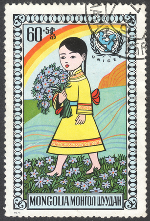 """unicef: MOSCA, RUSSIA - intorno al febbraio 2016: un francobollo stampato in MONGOLIA mostra un bambino felice, la serie """"Giornata dei bambini"""", intorno al 1977"""