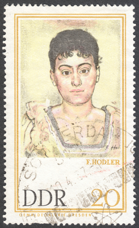famous paintings: MOSCOW, RUSSIA - CIRCA JANUARY, 2016: a stamp printed in DDR shows Portrait of Madame de R. by Ferdinand Hodler, the series Famous Paintings from Dresden Gallery, circa 1967