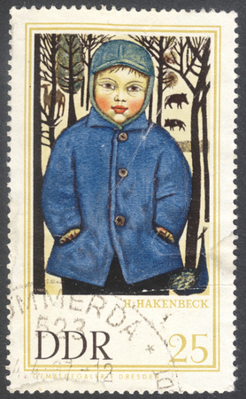 famous paintings: MOSCOW, RUSSIA - CIRCA JANUARY, 2016: a stamp printed in DDR shows the painting Peter in Tierpark by Harald Hakenbeck, the series Famous Paintings from Dresden Gallery, circa 1967 Editorial