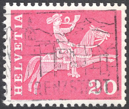 sello: MOSCOW, RUSSIA - CIRCA JANUARY, 2016: a post stamp printed in SWITZERLAND shows the 19th century mounted postman, the series Postal History and Architectural Monuments, circa 1960