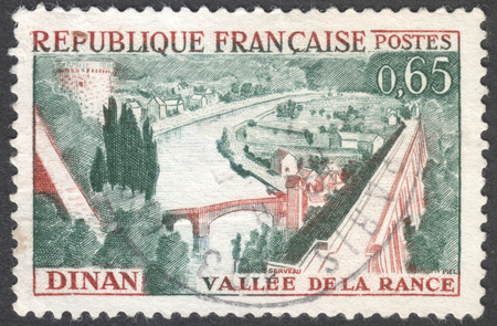rance: MOSCOW, RUSSIA - CIRCA JANUARY, 2016: a post stamp printed in FRANCE shows a view on the town of Dinan and river Rance, the series Tourist Publicity, circa 1961