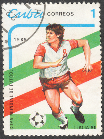 football world cup: MOSCOW, RUSSIA - CIRCA JANUARY, 2016: a post stamp printed in CUBA shows a football player, the series Football World Cup - Italy, 1990, circa 1989