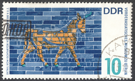 ishtar: MOSCOW, RUSSIA - CIRCA JANUARY, 2016: a stamp printed in DDR shows details of mythological animals from Ishtar gate Babylon 580 B.C., Pergamon museum Berlin, the series Art from Babylon, circa 1966