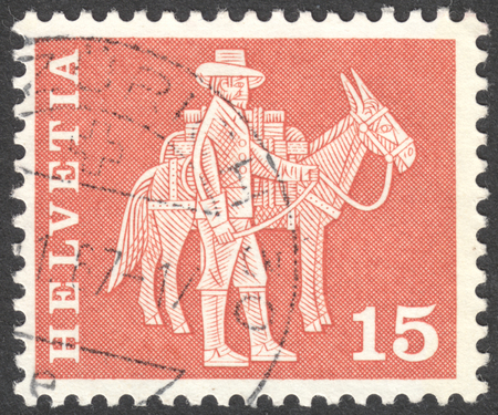 pack animal: MOSCOW, RUSSIA - CIRCA JANUARY, 2016: a post stamp printed in SWITZERLAND shows a mounted postman and a pack animal, the series Postal History and Architectural Monuments, circa 1960