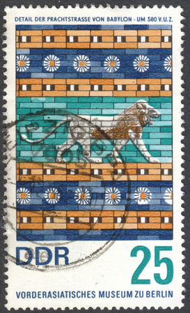 MOSCOW, RUSSIA - CIRCA JANUARY, 2016: a stamp printed in DDR shows details of mythological animals from Ishtar gate Babylon 580 B.C., Pergamon museum Berlin, the series Art from Babylon, circa 1966