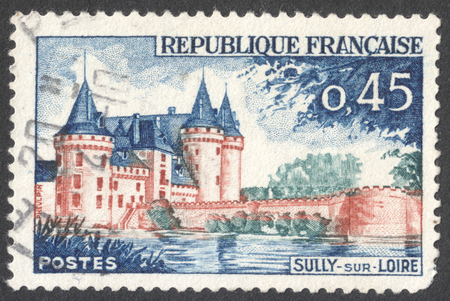 sully: MOSCOW, RUSSIA - CIRCA JANUARY, 2016: a post stamp printed in FRANCE shows a view on the Sully-sur-Loire Chateau, Loiret, the series Tourist Publicity, circa 1961 Editorial