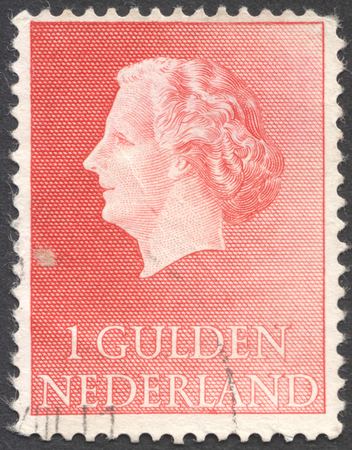 gulden: MOSCOW, RUSSIA - CIRCA JANUARY, 2016: a post stamp printed in NETHERLANDS shows a portrait of Queen Juliana, the series Queen Juliana, circa 1954