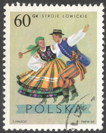 postmail: MOSCOW, RUSSIA - CIRCA JANUARY, 2016: a post stamp printed in POLAND shows traditional Polish dancing, the series Folk Costumes, circa 1969 Editorial