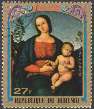 postmail: MOSCOW, RUSSIA - CIRCA JANUARY, 2016: a stamp printed in BURUNDIA shows painting The Virgin and Child by P. Perugino, the series Christmas - Various Paintings of The Virgin and Child, circa 1973