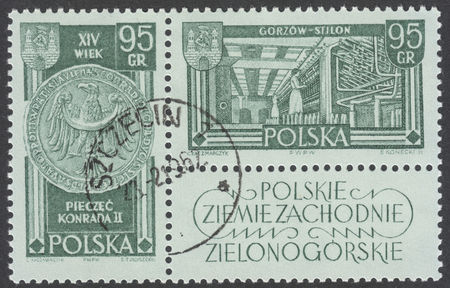 cement chimney: MOSCOW, RUSSIA - CIRCA JANUARY, 2016: a post stamp printed in POLAND shows King Konrad II and Stilon cloth factory in Gorzow Wielkopolski, the series Recovered Territories, circa 1961 Editorial