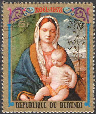 postmail: MOSCOW, RUSSIA - CIRCA JANUARY, 2016: a stamp printed in BURUNDIA shows painting The Virgin and Child by G. Bellini, the series Christmas - Various Paintings of The Virgin and Child, circa 1973
