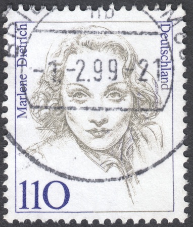 famous women: MOSCOW, RUSSIA - CIRCA JANUARY, 2016: a post stamp printed in GERMANY shows a portrait of Marlene Dietrich, the series Famous Women, circa 1997 Editorial