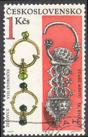 jeweled: MOSCOW, RUSSIA - CIRCA FEBRUARY, 2016: a post stamp printed in CZECHOSLOVAKIA shows gold earrings (the 8th-9th Century), the series Archaeological Discoveries in Bohemia and Slovakia, circa 1969