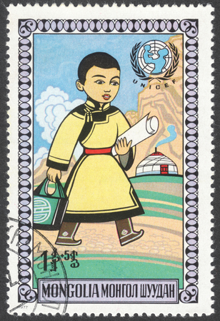 unicef: MOSCOW, RUSSIA - CIRCA FEBRUARY, 2016: a post stamp printed in MONGOLIA shows a happy child, the series Childrens Day, circa 1977