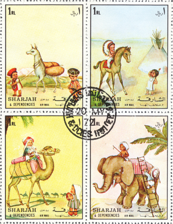 camel post: MOSCOW, RUSSIA - CIRCA JANUARY, 2016: a post stamp printed in SHARJAH shows animals, the series Types of transport, circa 1972