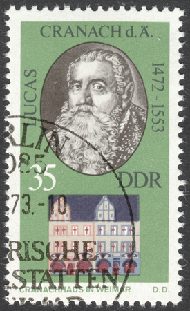 ddr: MOSCOW, RUSSIA - CIRCA FEBRUARY, 2016: a post stamp printed in DDR shows a portrait of Lucas Cranach, the Elder, the series Personalities and Their Homes in Weimar, circa 1973