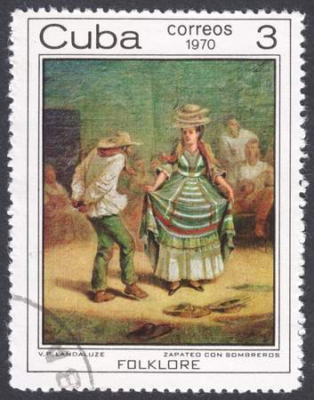 vp: MOSCOW, RUSSIA - CIRCA FEBRUARY, 2016: a post stamp printed in CUBA shows painting Dance with hats by V.P. Landaluze, the series The Afro-Cuban Folklore Paintings, circa 1970