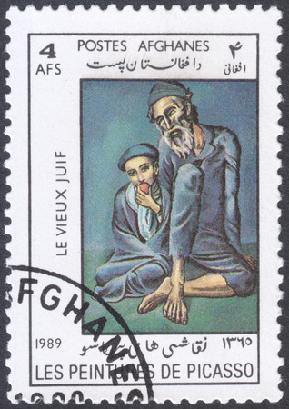 pablo picasso: MOSCOW, RUSSIA - CIRCA FEBRUARY, 2016: a post stamp printed in AFGHANISTAN shows painting Old Jew with a boy by Picasso, the series Paintings by Pablo Picasso, circa 1989