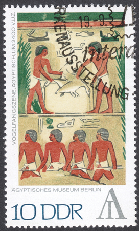 ddr: MOSCOW, RUSSIA - CIRCA FEBRUARY, 2016: a post stamp printed in DDR shows fowling scene, Egypt, the series Inernational Stamp Exhibition INTERARTES - Berlin, circa 1972