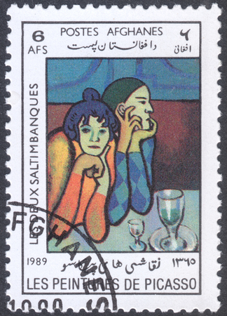 pablo picasso: MOSCOW, RUSSIA - CIRCA FEBRUARY, 2016: a post stamp printed in AFGHANISTAN shows painting Harlequin and his Companion by Picasso, the series Paintings by Pablo Picasso, circa 1989 Editorial